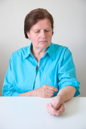 Mature woman  scratching her arm