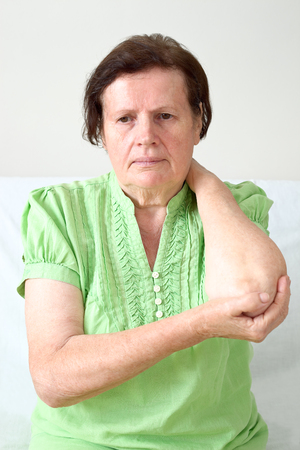 Senior woman with elbow pain