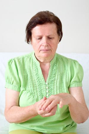 Senior woman with a wrist pain