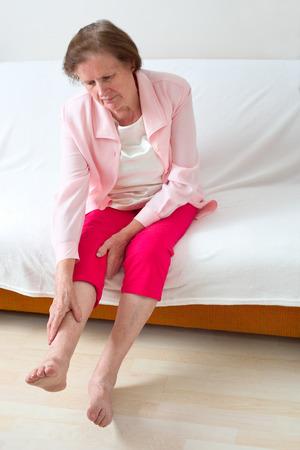 Senior woman with leg pain 스톡 콘텐츠
