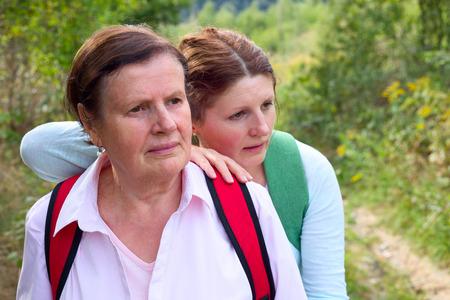 Two  tourist hiker women rest