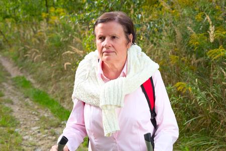 Senior lady nordic walking Stock Photo