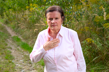 Senior woman with a chest pain