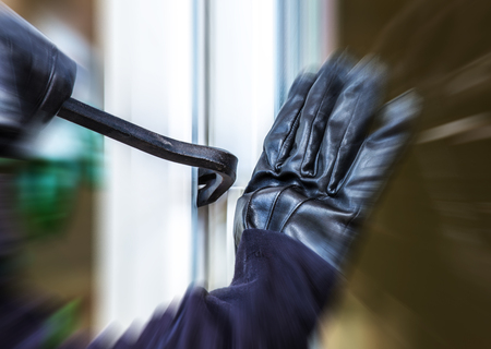 A burglar is going to break into a house Stockfoto