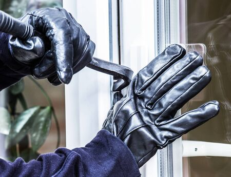 A burglar is going to break into a house Stok Fotoğraf
