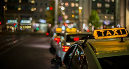 Taxis are available at night in a city waiting for passengers Stok Fotoğraf