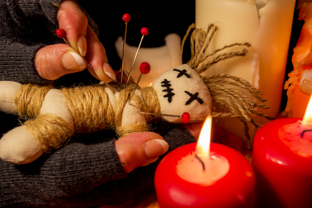 Voodoo, a doll lying on an altar with candles