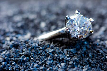 of irradiated: A lost ladys ring with a precious stone lies in the sand Stock Photo