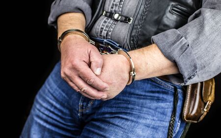 convicted: A man was handcuffed