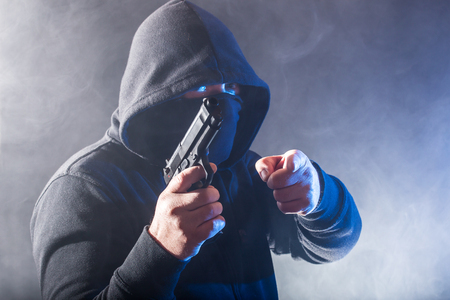 Attack - a gangster threatens with a weapon