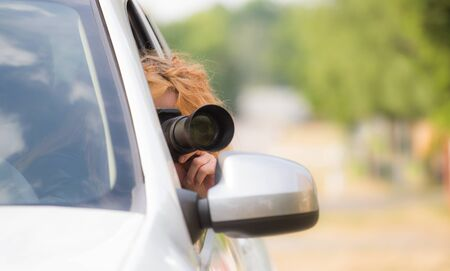 A woman secretly photographed from a car