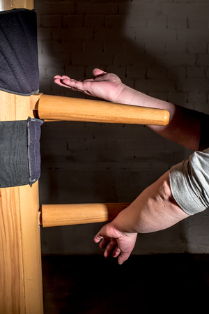 Martial arts training on a wooden dummy