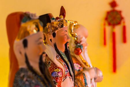 Chinese house gods and a talisman