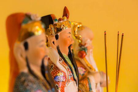 Chinese house gods and incense 版權商用圖片
