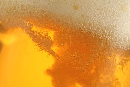 closeup of beer glass with bubbles photo