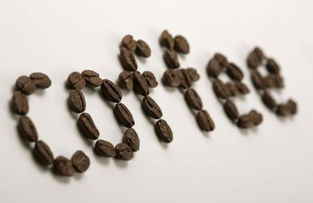 the word coffee written with coffee beans