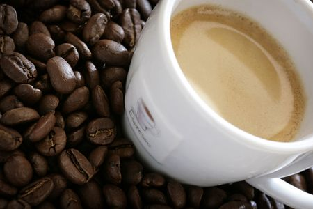 close-up of espresso cup with coffee beans around it Stock fotó