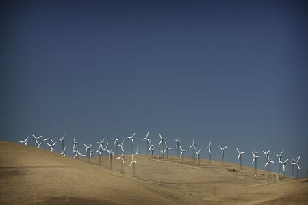 generate: Windmill on a hill to generate electricity