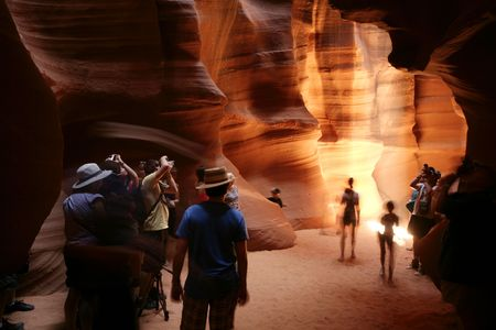 people taking pictures at the upper antelope canyon