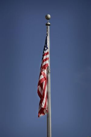 american flag hanging down with blue sky Stock Photo - 5281871