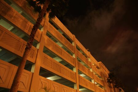 parking house at night with palm tree photo