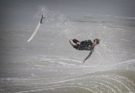 surfer in california flying over a wave photo