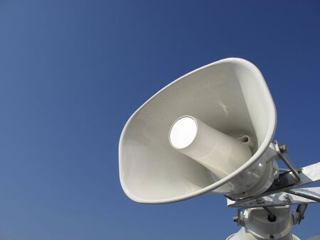 white loudspeaker for anouncements Stock Photo