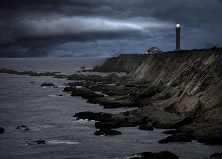 lighthouse during a storm photo