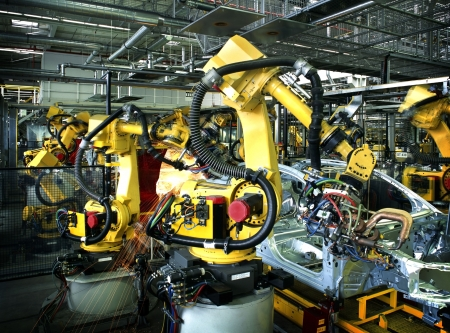 factory automation: welding robots in a car manufactory