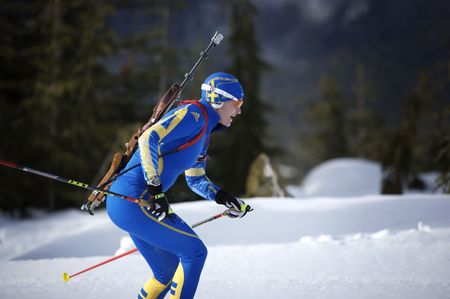 olympian: swedish Biathlon team training for the 2010 winter sports competitions in vancouver