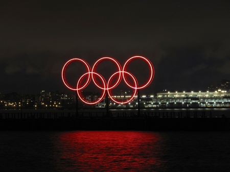 olympic symbol: olympic rings at night with canada plce in background