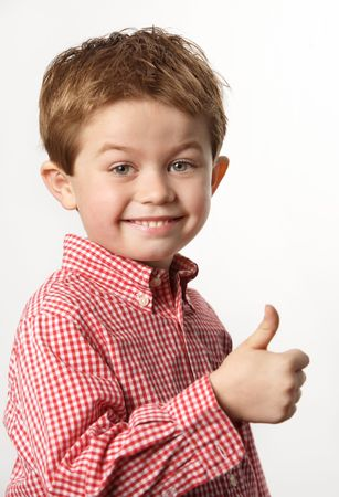 cute young boy with thumb up and smiling Stock Photo - 7027905