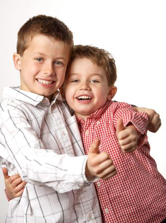 two cute young boys arm in arm with thumbs up Stock Photo - 7027909