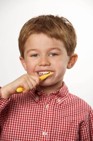 cute young boy brushing teeth with positive expression Stock Photo - 7027910