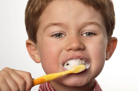 cute young boy brushing teeth with positive expression Stock Photo - 7027903