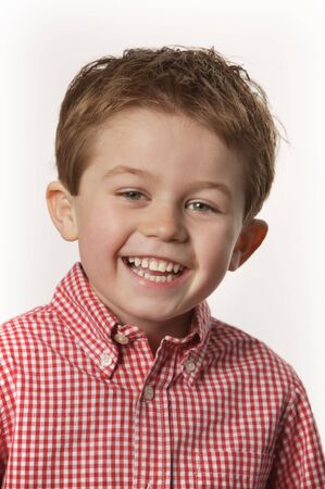 young boy smiling: cute young boy smiling with white bachground Stock Photo
