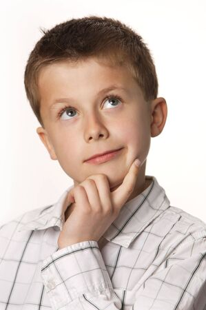 cute young boy thinking with white background