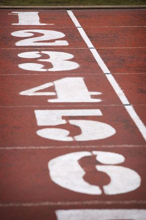finish line with numbers on a race track photo