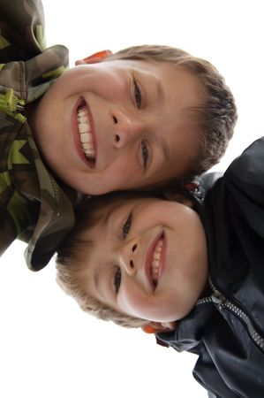 two cute young boys with a teethy smile Stock Photo - 7073578