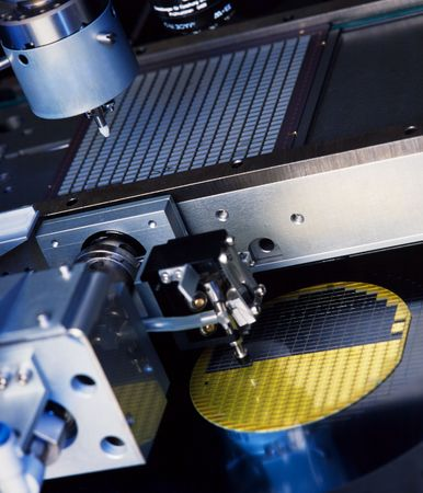 close up of electronic part production machine