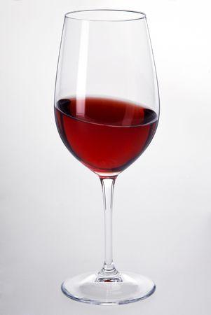 白い背景と赤ワインのグラス 写真素材