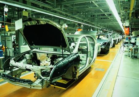unfinished automobiles in a car plant Reklamní fotografie