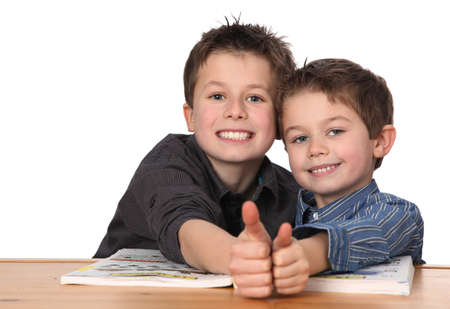 two cute young boys learning together photo