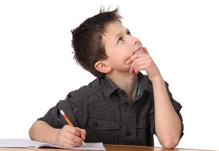 child learning: cute young boy learning with white background