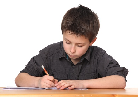 eager: cute young boy doing homework
