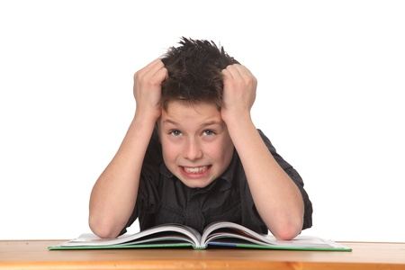 young boy frustrated over homework Stockfoto