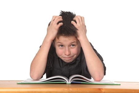 struggling: young boy frustrated over homework Stock Photo