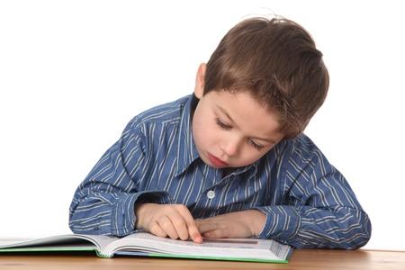 cute young boy doing homework