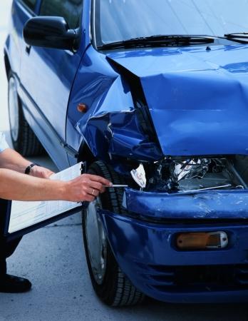専門家の車の損傷評価 写真素材