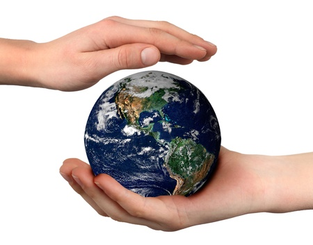 world (globe picture from NASA) in the palm of a childs hand photo